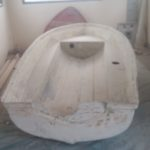 shipwrecked fibreglass dinghy before restoration